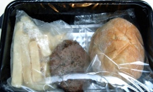 Packaged burger and chips in contact with plastic packaging