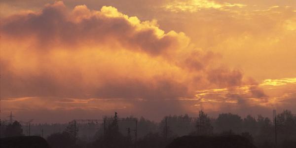 Smokestacks-against-skyline