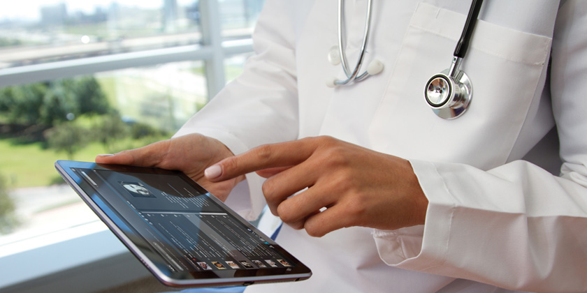 image of doctor-and-tablet