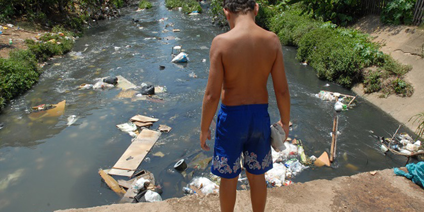 image of child-and-polluted-river